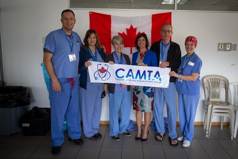 CAMTA team standing behind a camta banner